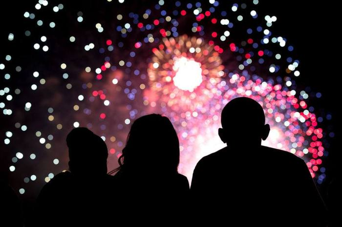 President Barack Obama, First Lady Michelle Obama, and Malia Obama, center, watch the Fourth of July fireworks from the roof of the White House, July 4, 2014. (Courtesy of President Obama FB Page)